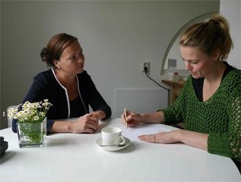 Coaching gesprek aan tafel